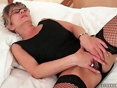 Peerless old little one in glasses and fishnets masturbates