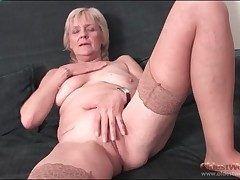 Granny strips nigh stockings and fingers pussy