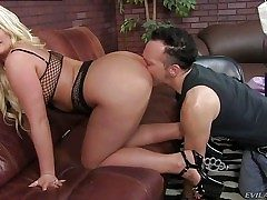 Julie Cash is a curvaceous blonde domina with big tits